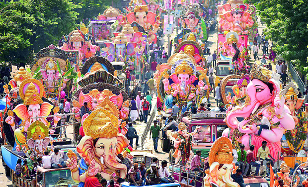 Heavy flow of Ganesh idols was witnessed on the Tank Bund stretch on Monday. (Photo:  DC)