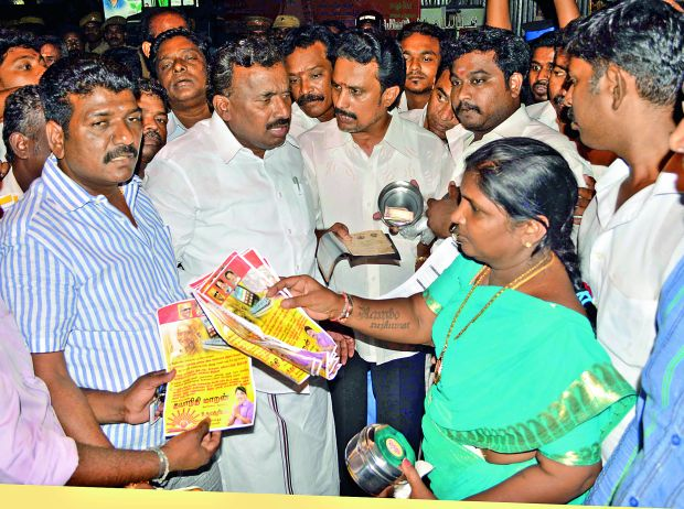 Chennai Mayor Saidai S. Duraisamy receives a complaint lodged by AIADMK councillors against cash-for-vote in Central Chennai Wednesday. (Photo: DC)