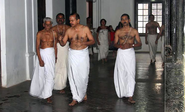 Moolam Thirunal Rama Varma (centre) along with priests arrive at Sree Padmanabha Swamy temple to take part in rituals as part 'Thirumuti Kalasa Pooja' on Friday - DC/Peethambaran Payyeri