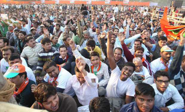 BJP supporters shout slogans during the election rally of BJP PM candidate Narendra Modi in New Delhi on Sunday. PTI