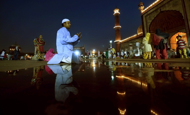 A man pray before break his fast on the first Iftar of the holy month of Ramadan at Jama Masjid in New Delhi (Photo: AP)