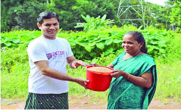 Hibi Eden, MLA, accepts the Rice Bucket Challenge by handing over a bucketful of rice to Kochu Rani