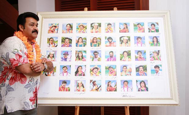 Mohanlal poses with the collector's edition paintings