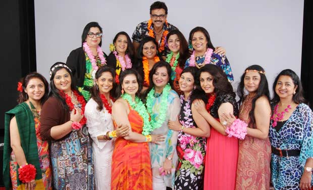 Venkatesh poses with the women