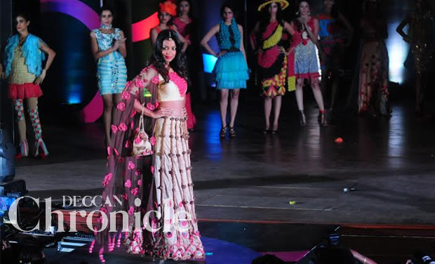 An Indian condom brand conducted India's first design contest and fashion show 'SKORE Fashionista', in Mumbai.  Mugdha Godse, celebrity showstopper, was the highlight of the event, displaying condom wear designed by the students. Photo: Debasish Dey