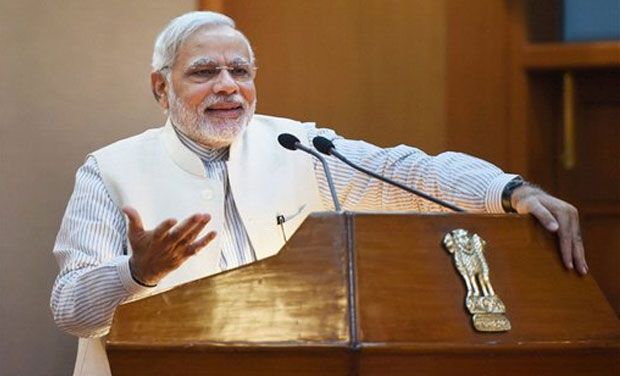 Prime Minister Narendra Modi speaks after releasing commemorative postage stamps on the 2014 FIFA World Cup in New Delhi on Thursday. (Photo: AP)