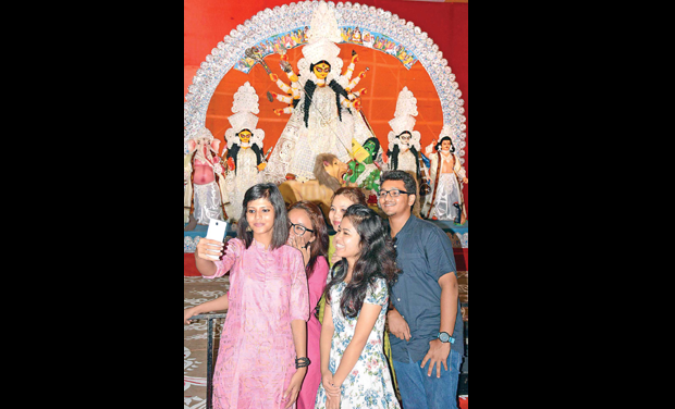 Young Bengalis take a selfie with the Goddess at the Besant Nagar pandal as Durga puja celebrations kickstart in the city. (Photo: DC)