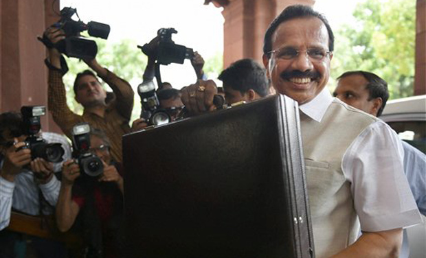 Railway minister Sadananda Gowdaarrive at the parliament to present the Rail Budget (Photo: AP)